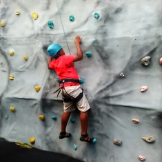 My son rock climbing