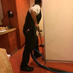 The housekeeper shampooing outside the bathroom