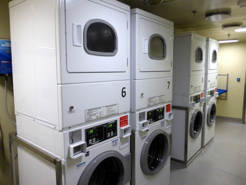 Inside the laundry room - 8 quarters for a wash - free dry - Amsterdam