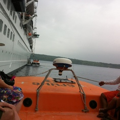 On the top of life boats heading to tender port
