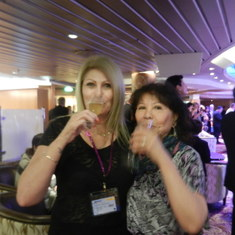 Christine & a female partner drink champagne at Captain Welcome Party