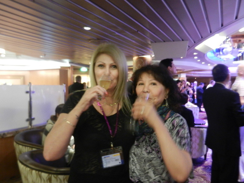 Christine & a female partner drink champagne at Captain Welcome Party - Rhapsody of the Seas