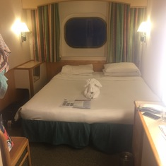Oceanview stateroom with window. Two twin beds pushed together.