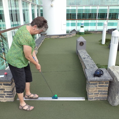 Playing mini-golf
