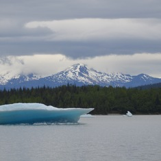 Viewing an iceberg from Mendenhall Glacier below the Alaska mountain skyline.