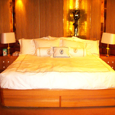 Bed in Pinnacle Suite, Cabin 7001 taken Feb 2012 before Dry Dock.  Logos