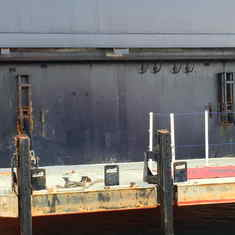 Heavily-rusted tender boat landing - and handrails almost rusted through!