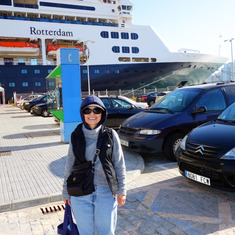 My wife  in front of our ship, ms Rotterdam, in Cadiz, Spain.