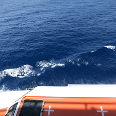 The partially obstructed view with the lifeboats below our deck.