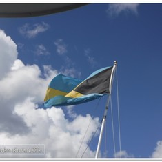 Bahamian flag flying on back of ship