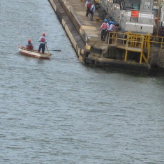 Crew taking our lines to the mules in Gatun Locks