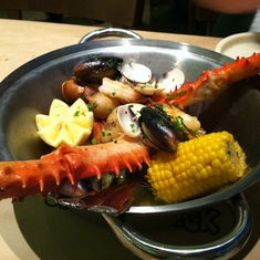 Crab legs and corn in the Crab Shack on Royal Princess