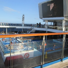 A PART OF THE TOP DECK (JACUZZIS, POOL,  TV)