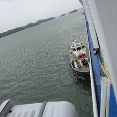 Pilot & his crew boarding to take us to the Gatun Locks.