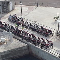 Scooters parked by the ship