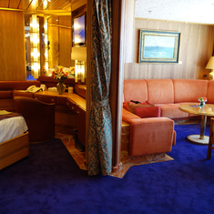 View of Bedroom Entrance and Living Room in Pinnacle Suite, Cabin 7001