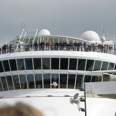 Passengers of the Disney Magic watching the Norwegian Royal Family come ashore