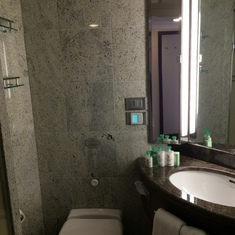Small but well appointed bathroom with full bath on right.