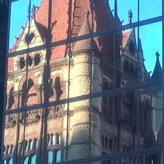 New highrise with reflection of beautiful church across the Copley square area.