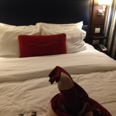 nicely made bed w/ a little surprise. I want more chocolates please for 5 peeps!
