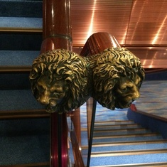 Lion head decor at the end of the stairwell