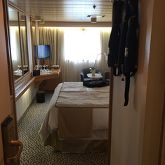 View into stateroom at entrance door. Bath on right, closets on left.