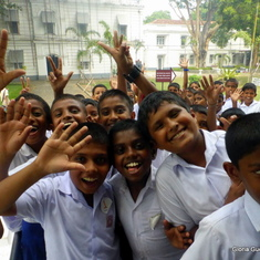 School Boys wavi8ng to me at the Colombo Museum