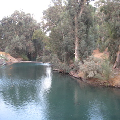 Jordan River--Many tourist baptisms here
