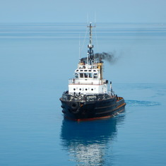 Our tug waiting to guide us into the Bermudian port.