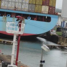 Adjecent ship with Gatun Locks gates closing.