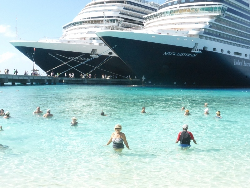 Swimming at the beach with the ships in the background - Koningsdam