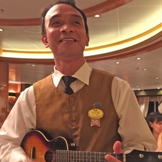 Singing Waiter accompanied by his Ukulele